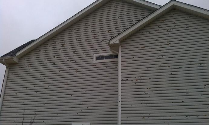 Cyrena hail damage house